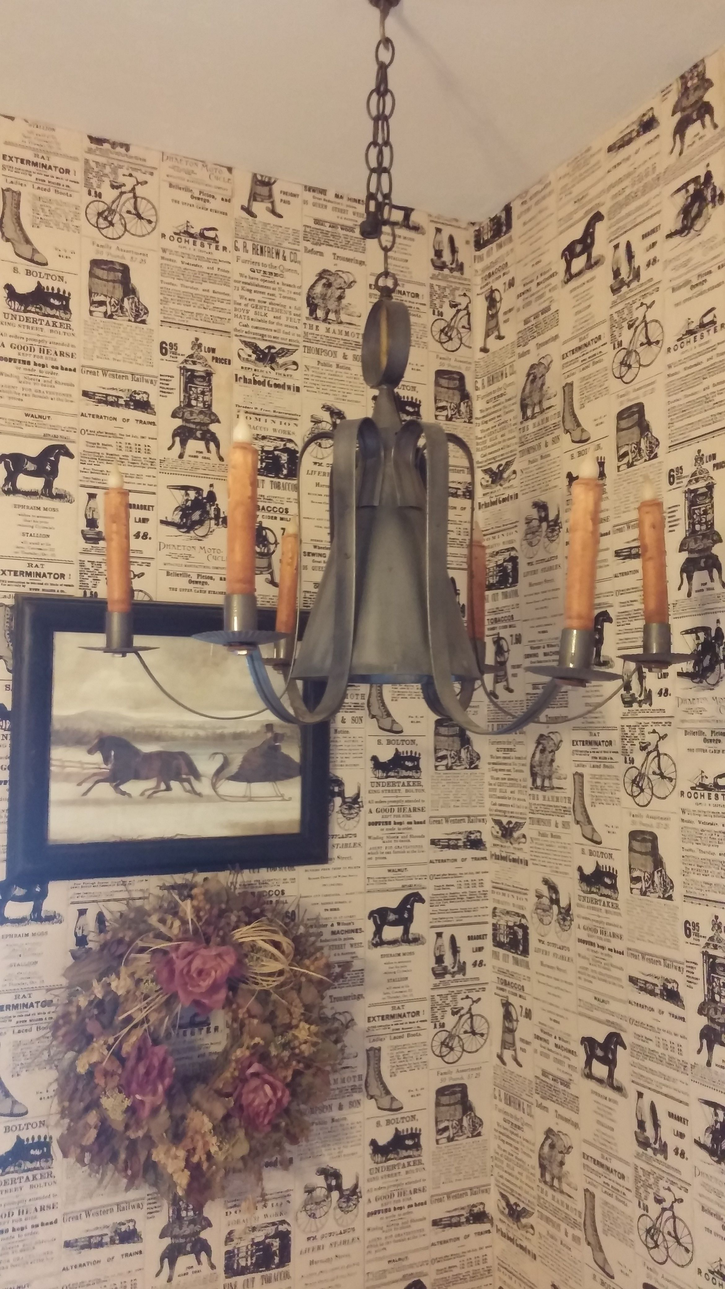 Recycled electric tin lamp. Removed wires and added grunge timer candles. Antique wallpaper for the finishing touch.