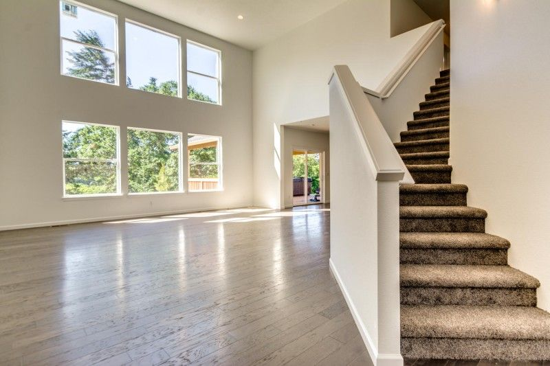 Beautiful, large windows, hardwood floors, and an open staircase ...