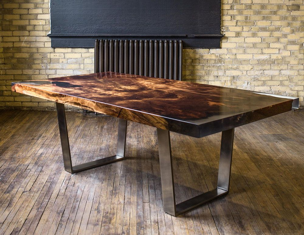 custom dining table made of historic redwood with clear resin and antique pewter legs