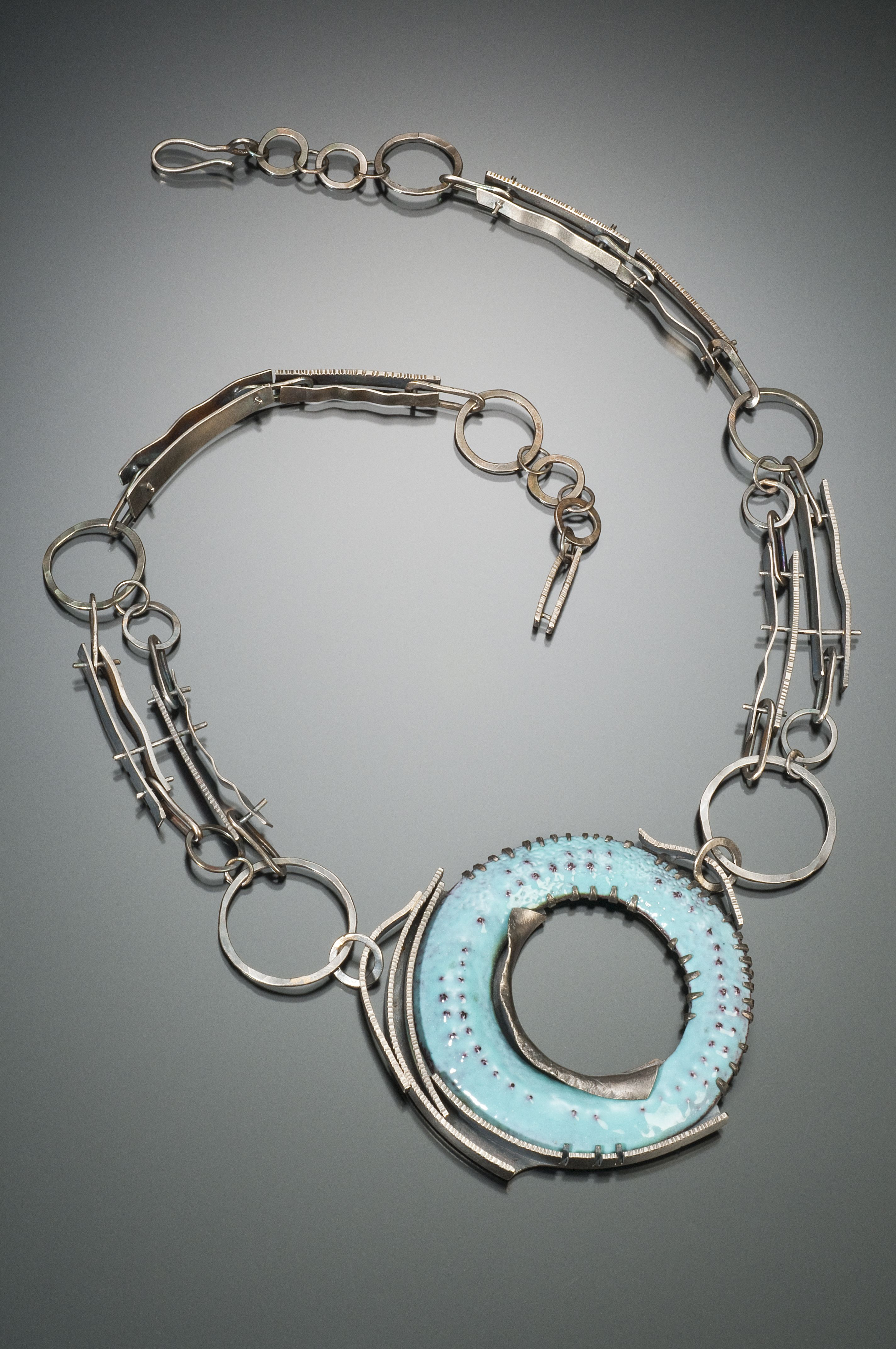 This is enamel on copper and sterling silver. Photo by Robert Diamante