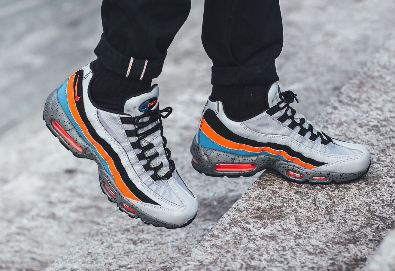 The Nike Air Max 95 Premium in wolf grey safety orange university blue is fdf44d55c7