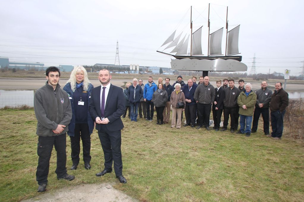 Gareth Phillips from GJM, coastal ranger Karen Rippin and Flintshire County Council leader Aaron Shotton, with assembled guests and visitors and the finished sculpture