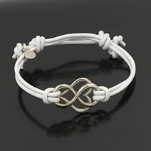 cute it has a heart and infinity circle and I feel like the bracelet is to hands holding it lol love!
