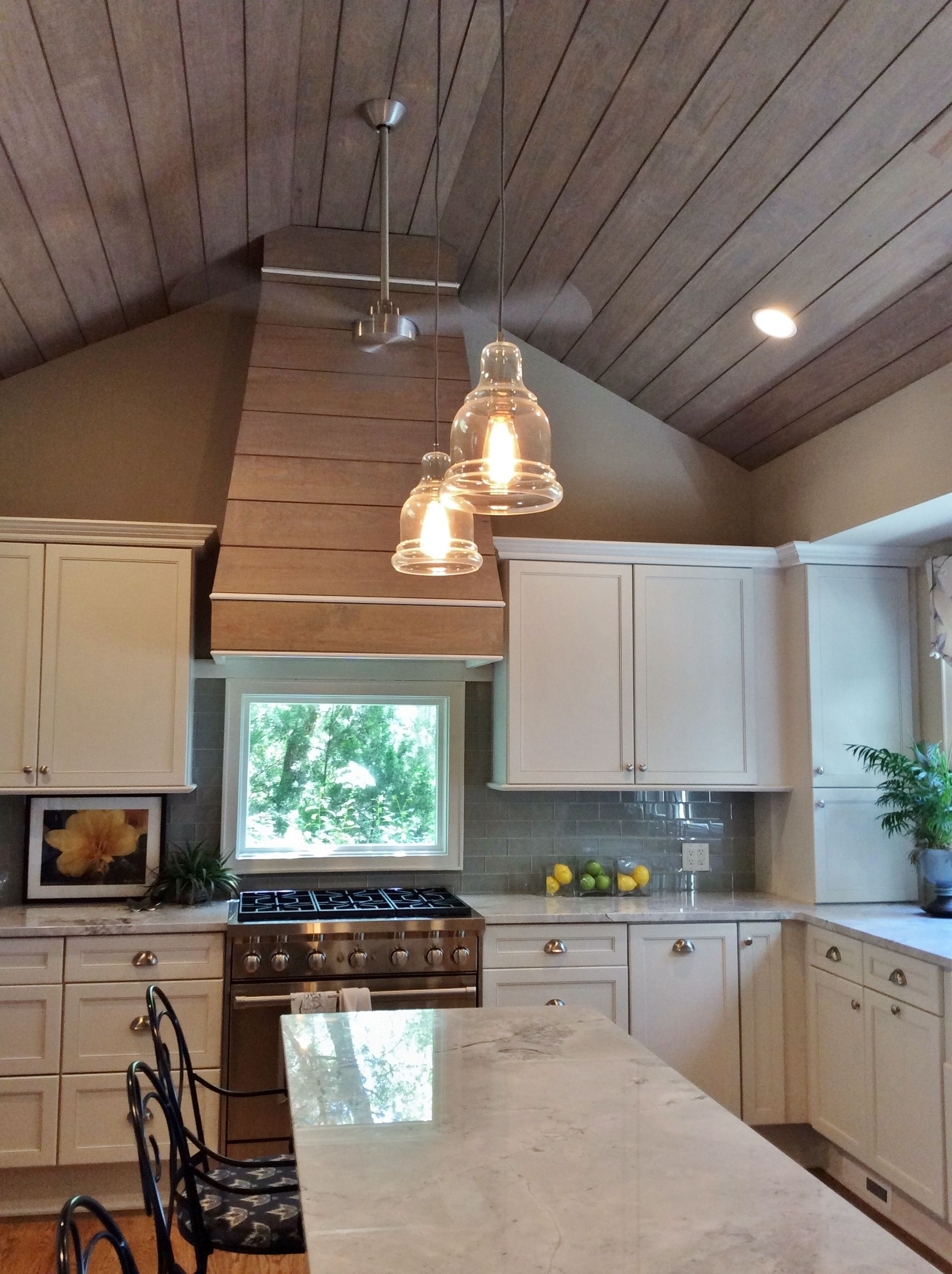Hood concept shiplap siding was added to the kitchen