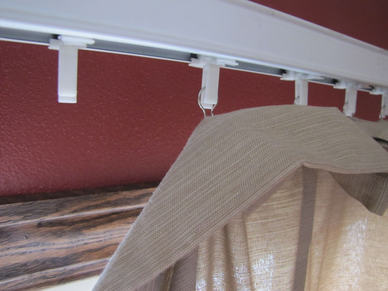 Egress window decor  the idea of keeping plastic vertical blinds with just a valance