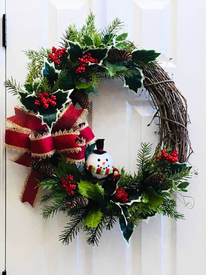 Photo of 18″ Round Grapevine Wreath with Round Snowman, Holly and Berries, Pinecones, and Red and Burlap Bow