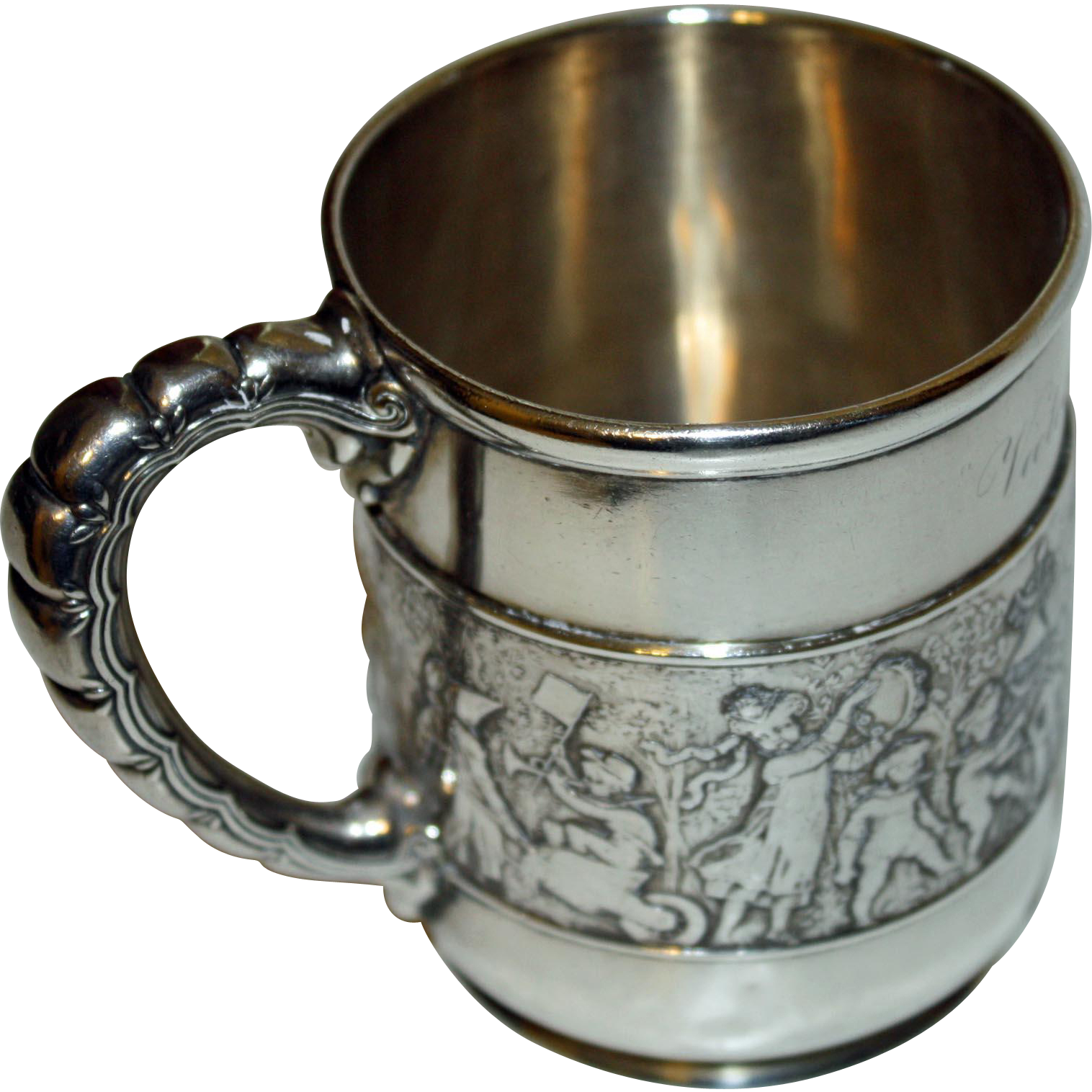 This stunning child's mug or cup was made by Tiffany and it has the quality Tiffany represents. The design is called Children's Parade and depicts