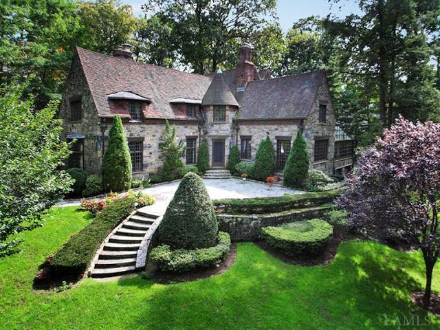 What a fantastic tudor home....great landscape.