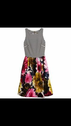 This dress is so cute! Love the shape and the mixed prints. Funky but not too much.