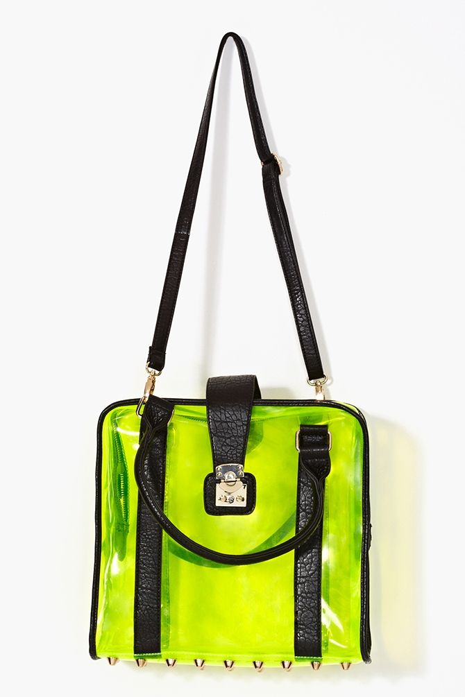 fe98df27f81a Neon yellow jelly tote bag featuring black vegan leather handles and a gold  studded bottom. Push-lock and zip closures