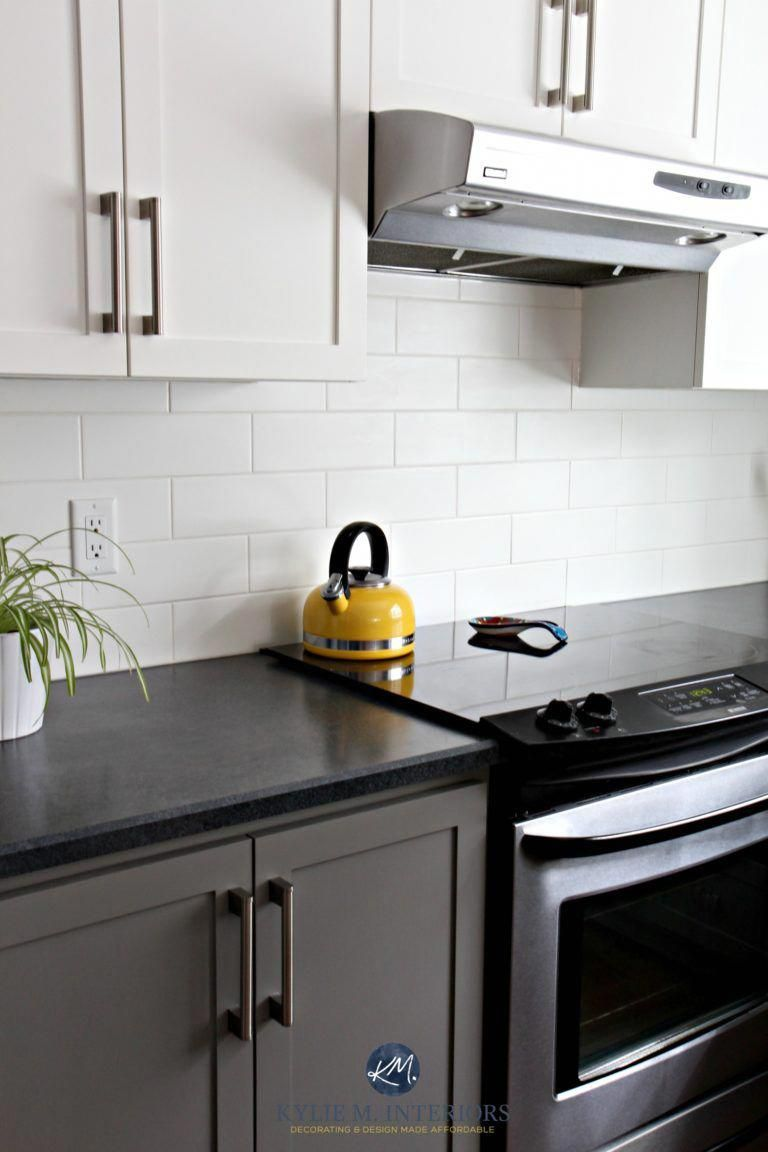 Kitchen With Chelsea Gray Subway Tile Black Laminate Countertop