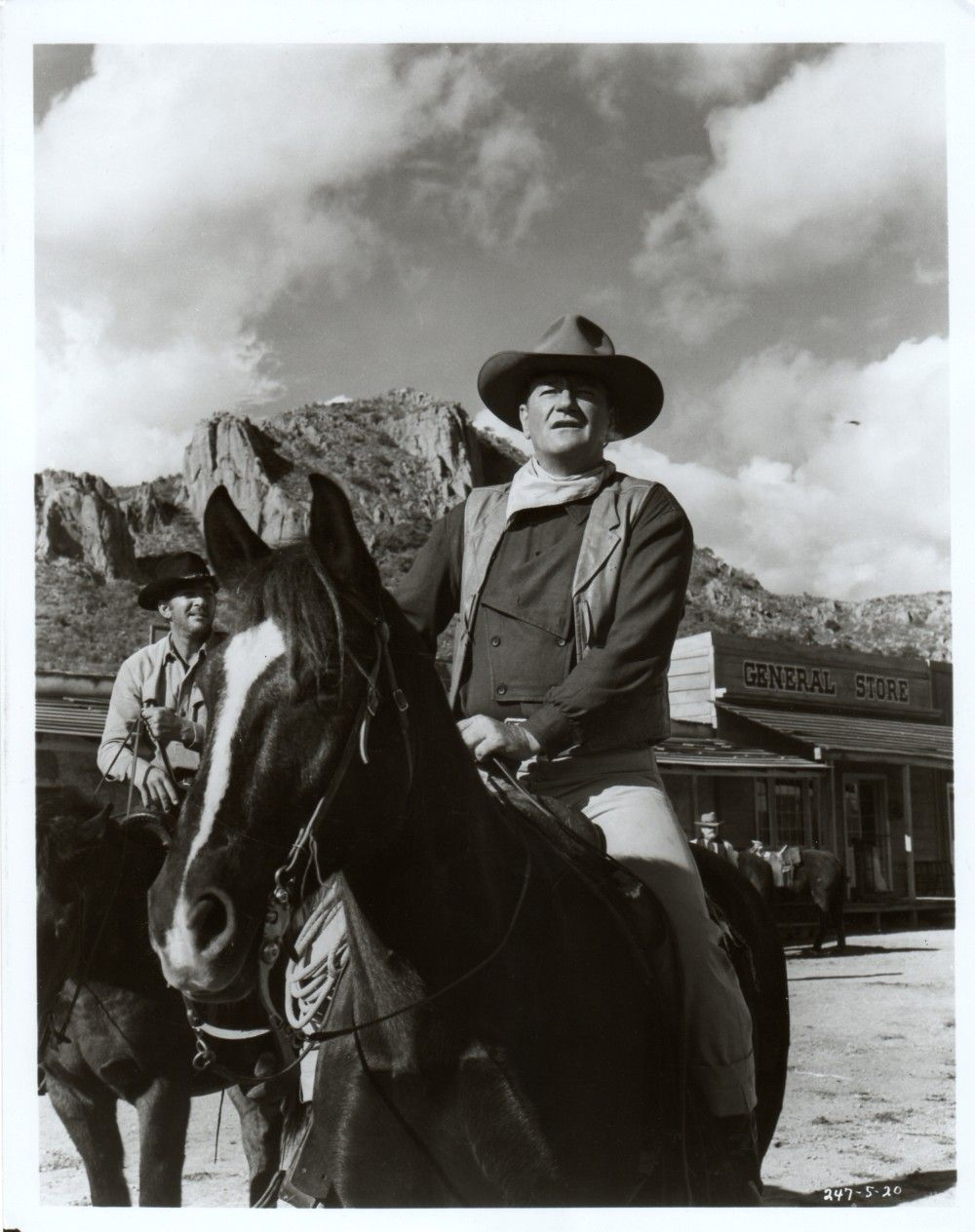 THE SONS OF KATIE ELDER (1965) - John Elder (John Wayne) on horseback with Dean Martin - Durango, Mexico - Produced by Hal Wallis - Directed by Henry Hathaway - Paramount Pictures - Production Still.