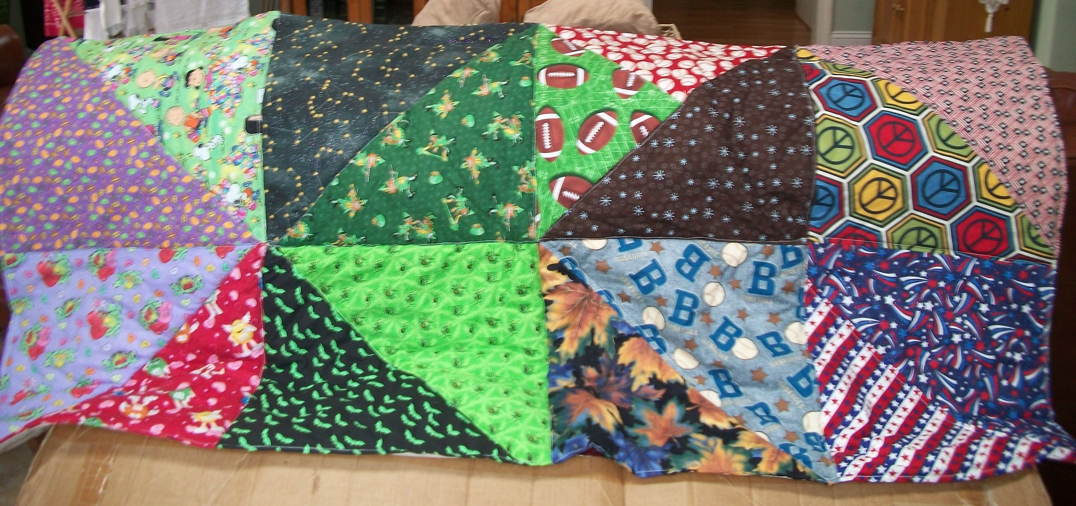 Saved bandanas from dog groomer to make this quilt Pets