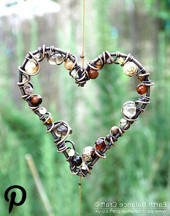This sun catcher has three heart shaped hanging ornaments made from copper wire wrapped with agate a This sun catcher has three heart shaped hanging ornaments made from c...