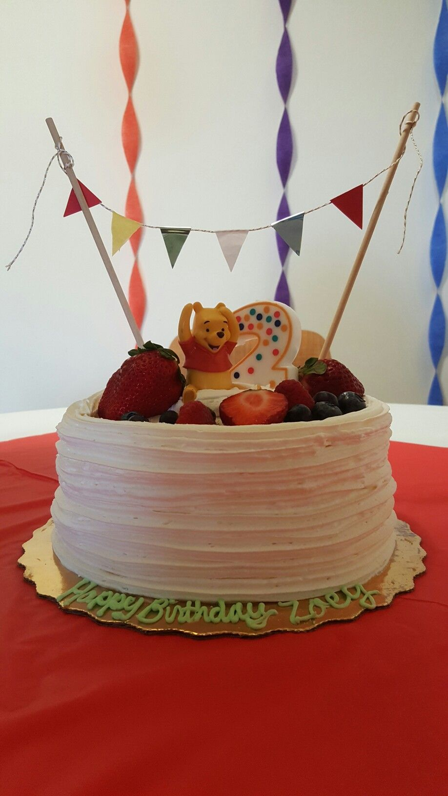 If you don't have the time or the talent of baking, buy some toy and and make a mini-banner to decorate a bakery cake
