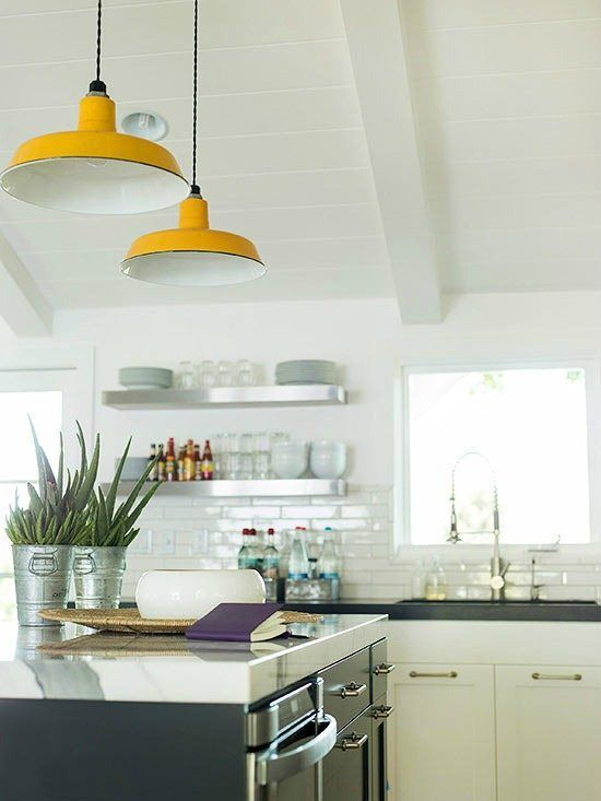 The retro style fixtures brightly contrast the kitchens sleek modern aesthetic and muted colors while drawing eyes upward
