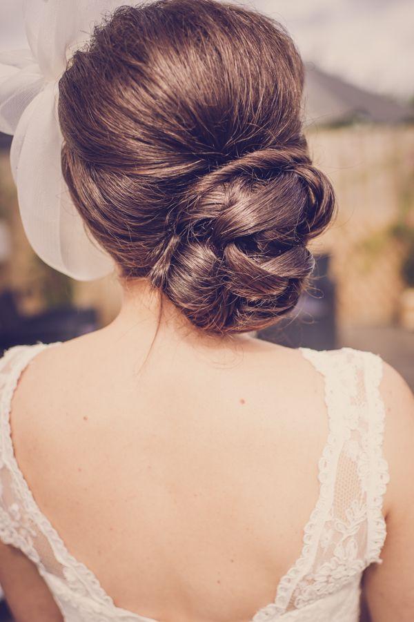 bun hair bride quirky beach wedding http://www.marcsmithphotography.com/