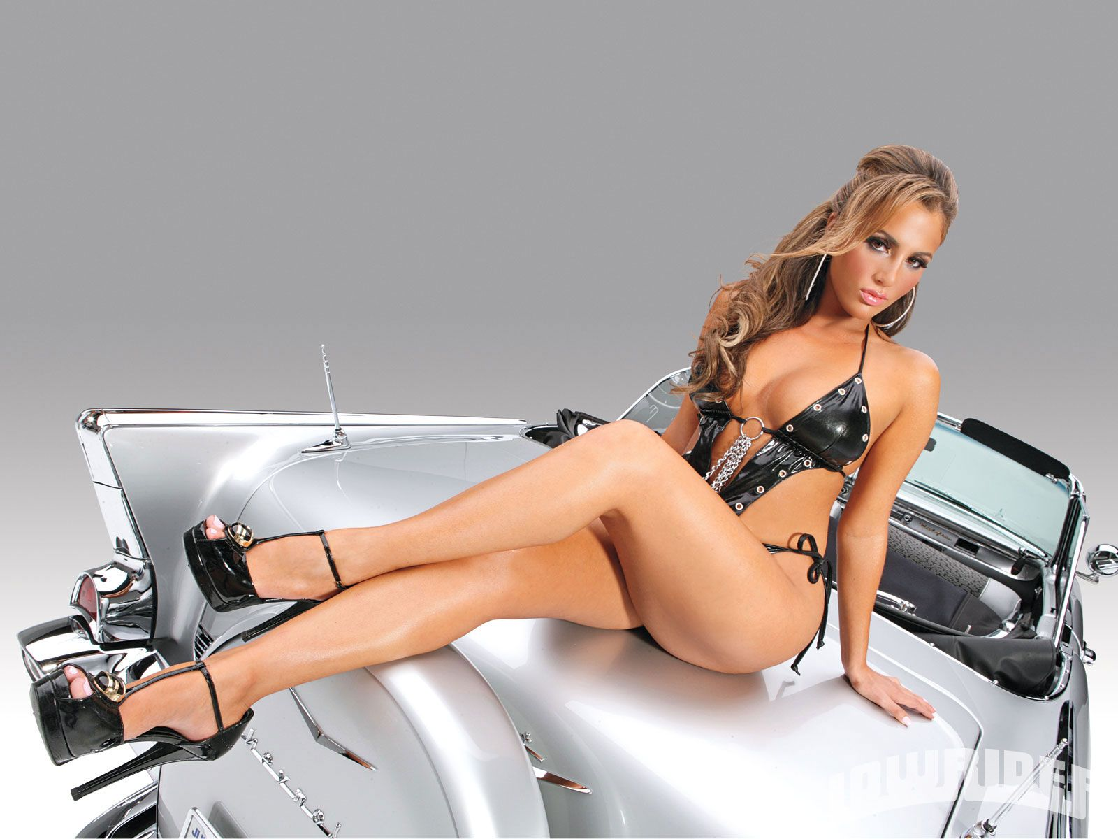 Lowrider Magazine model Natalin Avci on a silver 57 Chevy convertible. Lowrider Cars Wallpapers