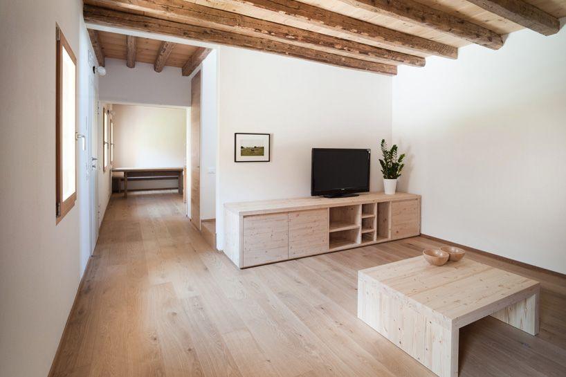 massimo galeotti enhances casa fiera with brick and wood