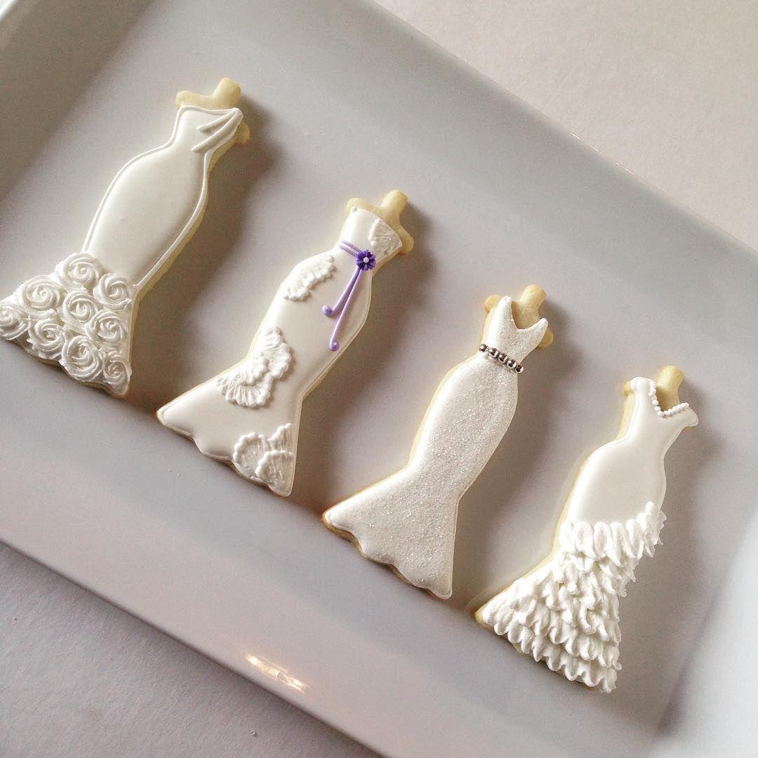Wedding Dresses... #littlemissmoffatcookies #bridalcookies #weddingcookies #decoratedcookies #customdecoratedcookies #customsugarcookies