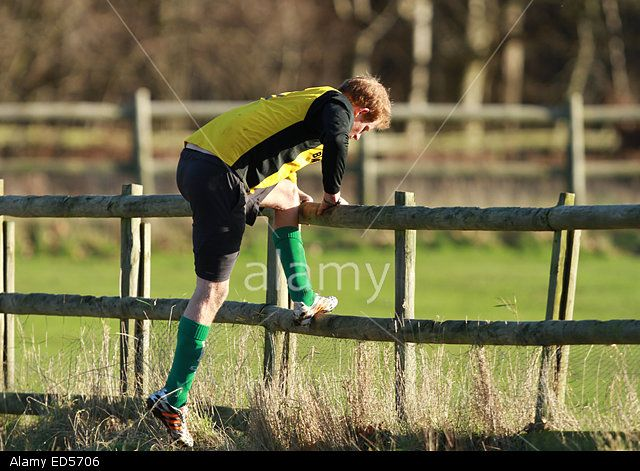 Prince Harry playing football . . Castle Rising, Norfolk, UK . . 24.12.2014 HRH Prince Harry leaps over a fence after retrieving the ball as he took part in an annual charity football match involving estate workers from Sandringham. Pic: Paul Marriott Photography Stock Photo