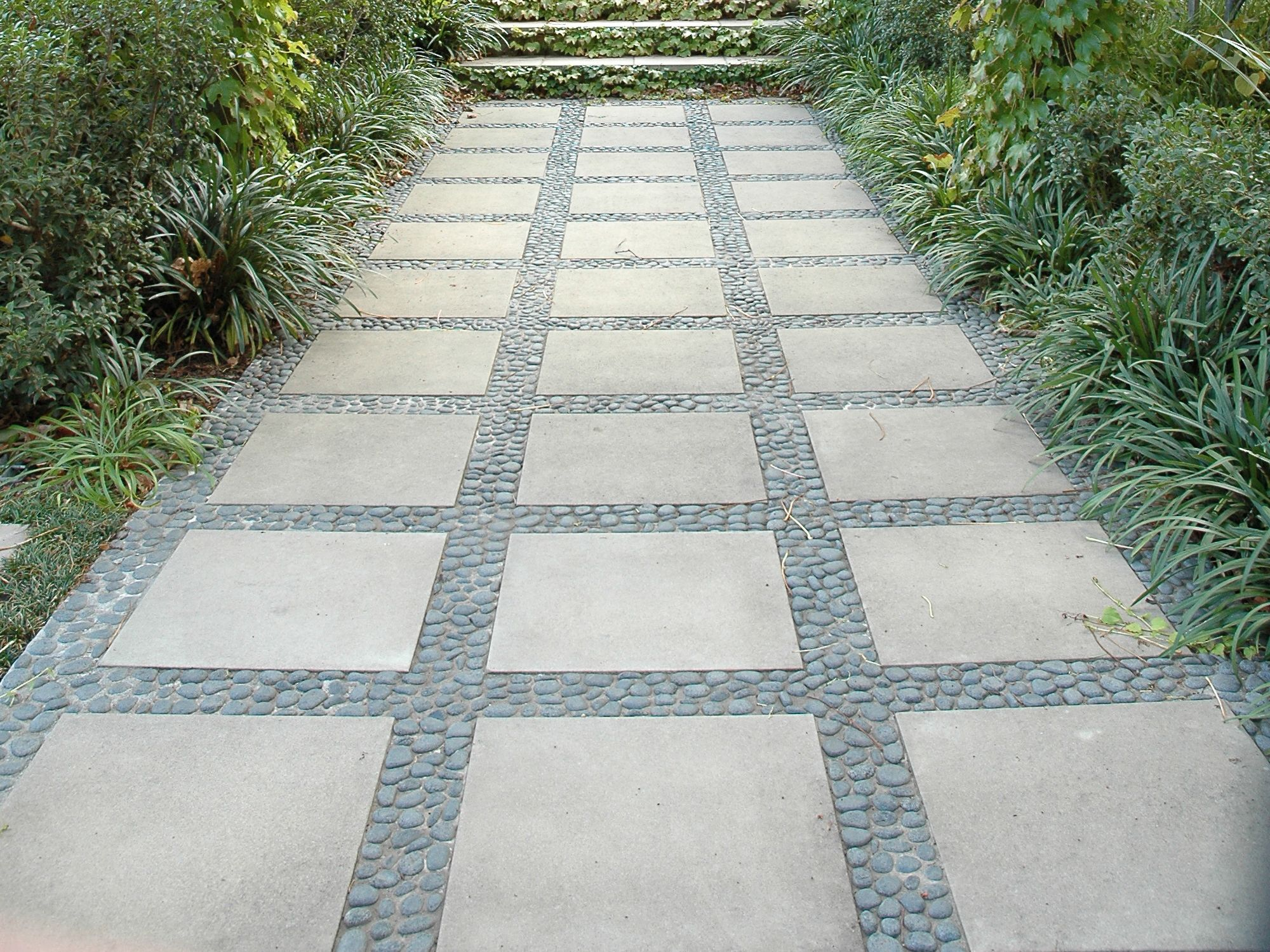 Eco Outdoor Anvil Pebbles Laid With Taupe Concrete Pavers Eckersley Garden Architecture Eco Outdoor Outdoor Paving Natural Stone Flooring Outdoor Flooring