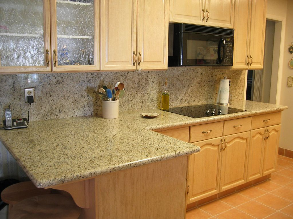 Giallo ornamental granite is a veined granite with a for Small kitchen granite countertops