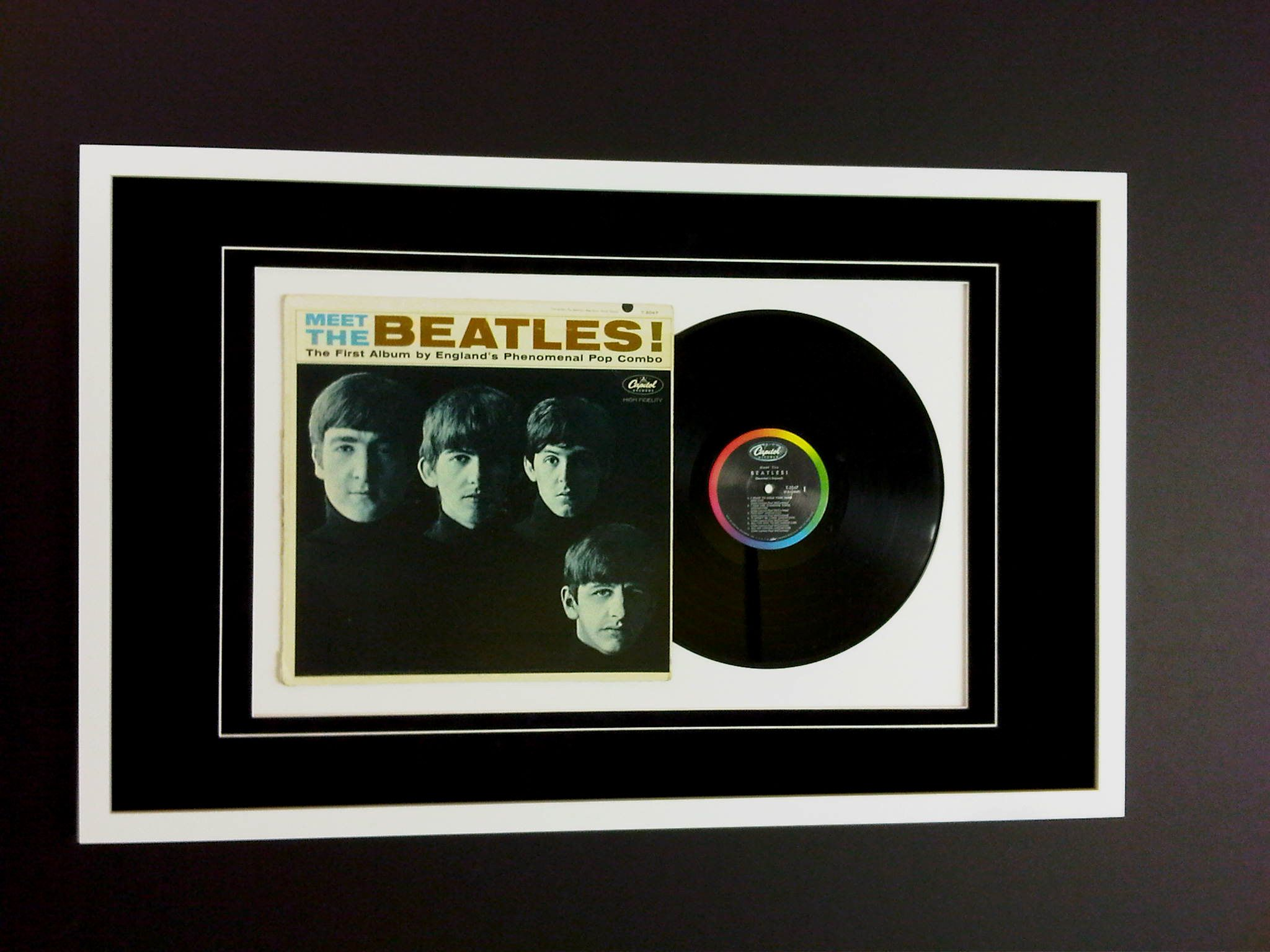 Just finished framing The Beatles First Album, that I pinched off me ...