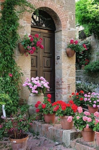 Pretty front porch with geraniums