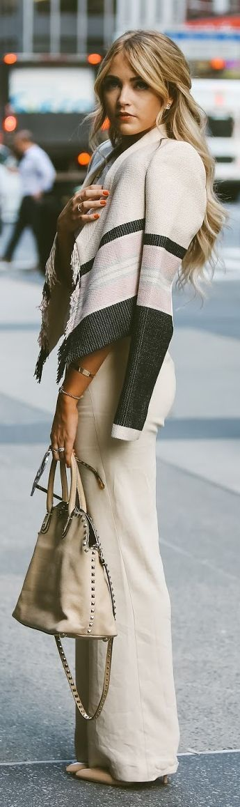 Latest fashion trends: Street style | Off white elegant flared trousers with color block fringed jacket