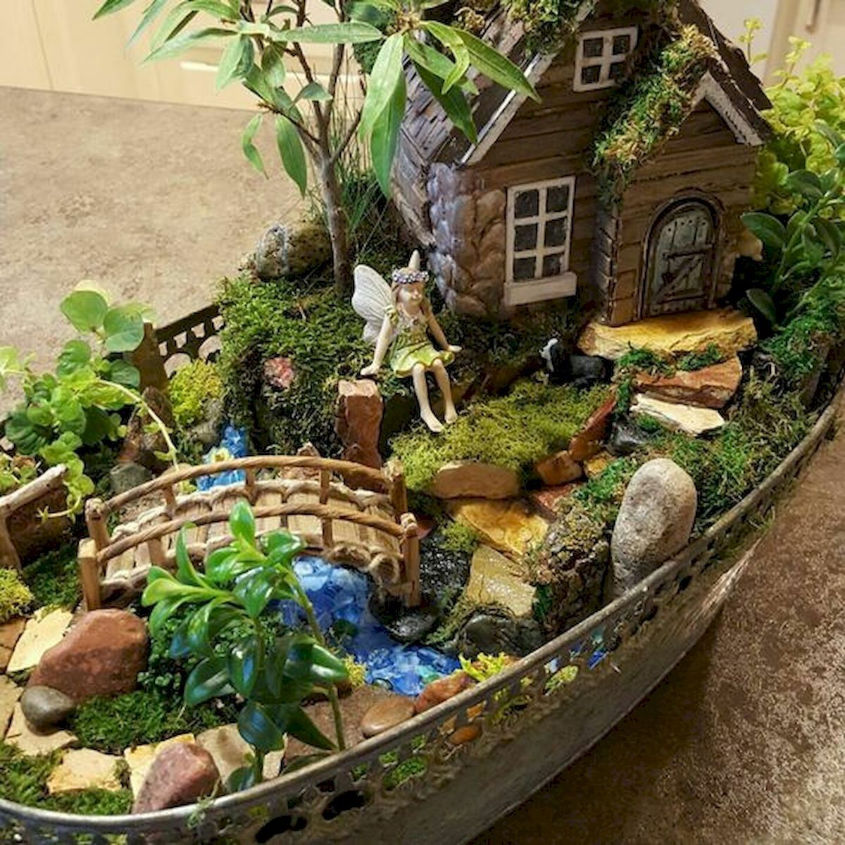 A Fairy Garden Is Basically A Miniature Garden Made Of Natural Materials Such As Pebbles Wood And Li Indoor Fairy Gardens Fairy Garden Houses Miniature Garden