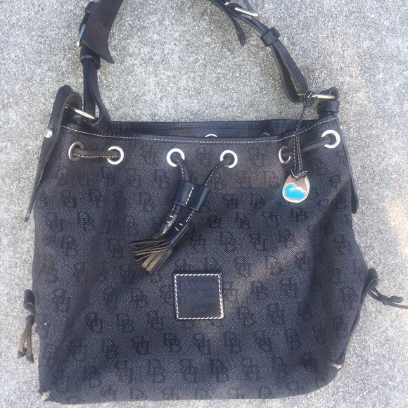 Dooney and bourke Black purse is used but nice Dooney & Bourke Bags Shoulder Bags