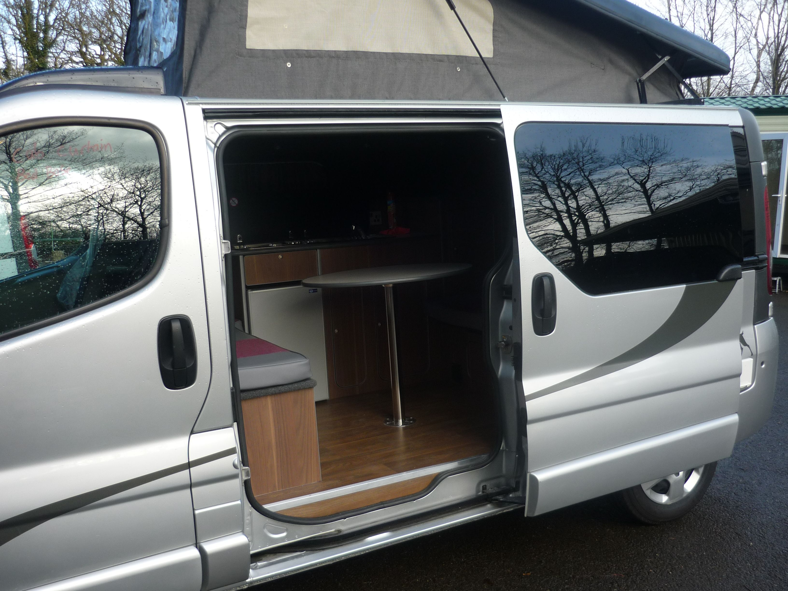A view of the inside of our manhattan campervan conversion from the outside showing just