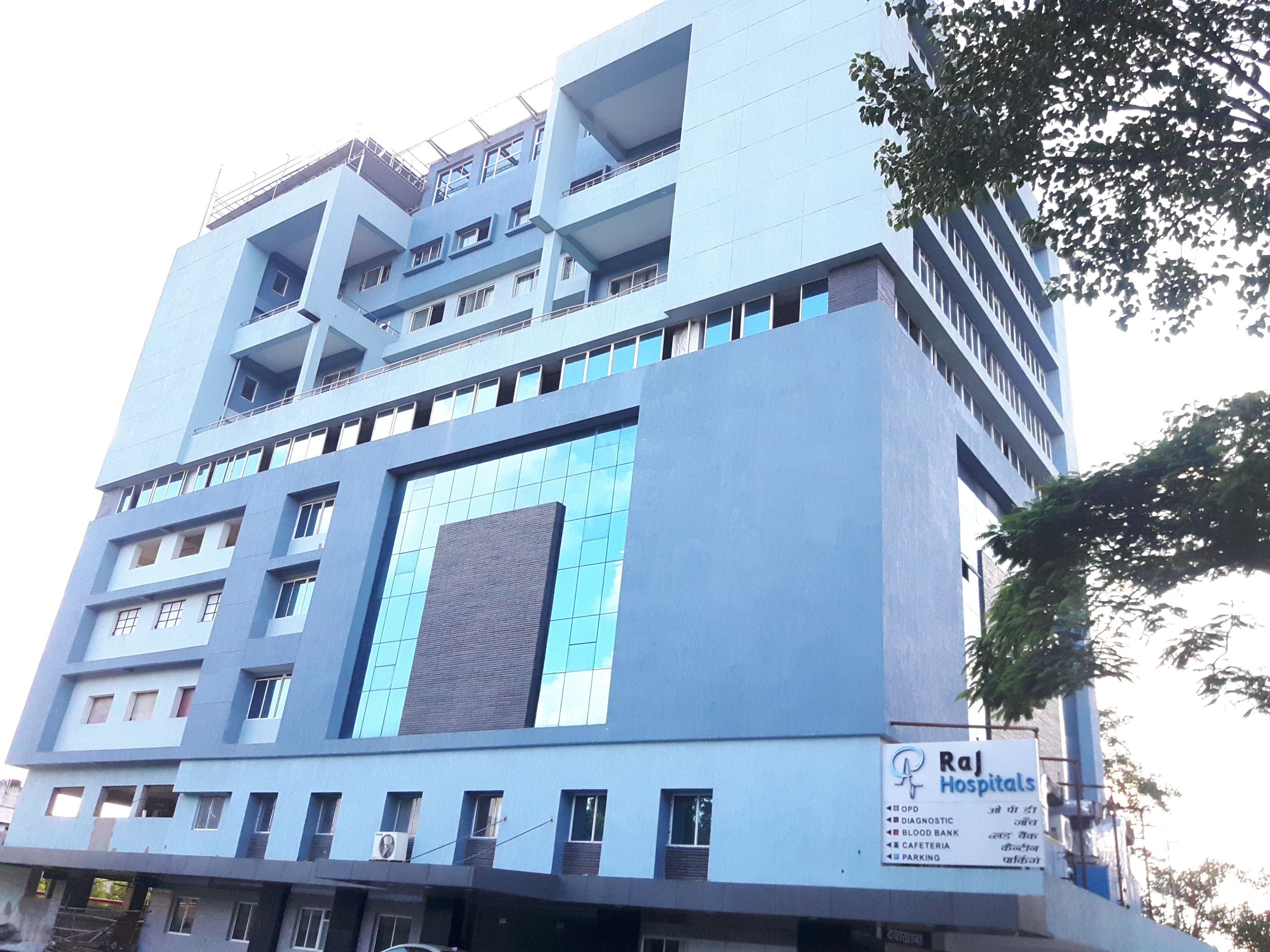 """RAJ HOSPITAL - 1st Hospital in India where a person can be evacuated from  any floor within a while. """" provision of Helipad"""".   Hospital,  Architecture, Building"""