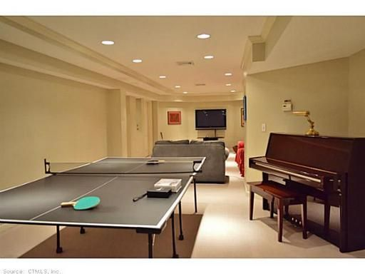 A Beautiful Small Game Room With A Ping Pong Table And A Piano Small Game Rooms Game Room Ping Pong Table
