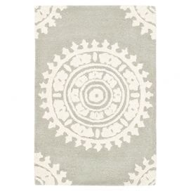 Hand-tufted wool rug with medallion motif.Product: Rug  Construction Material: Wool  Color: Light gray and ivory  Features: Hand-tufted  Made in India Note: Please be aware that actual colors may vary from those shown on your screen. Accent rugs may also not show the entire pattern that the corresponding area rugs have.Cleaning and Care: Professional cleaning recommended