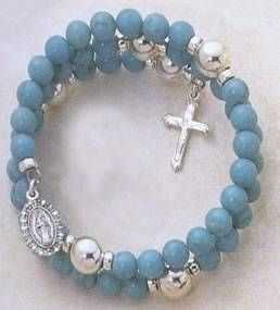 How to Make a Coil Rosary Bracelet - My future sisters-in-law are Catholic, so this could be a neat thing to make.