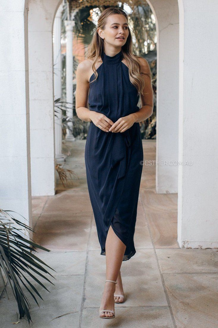 The amaryllis dress in navy is a dream with halter neck low back