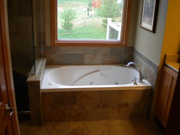 Tile aound sunken tubs whirlpool tub with custom tile for Whirlpool bathroom designs