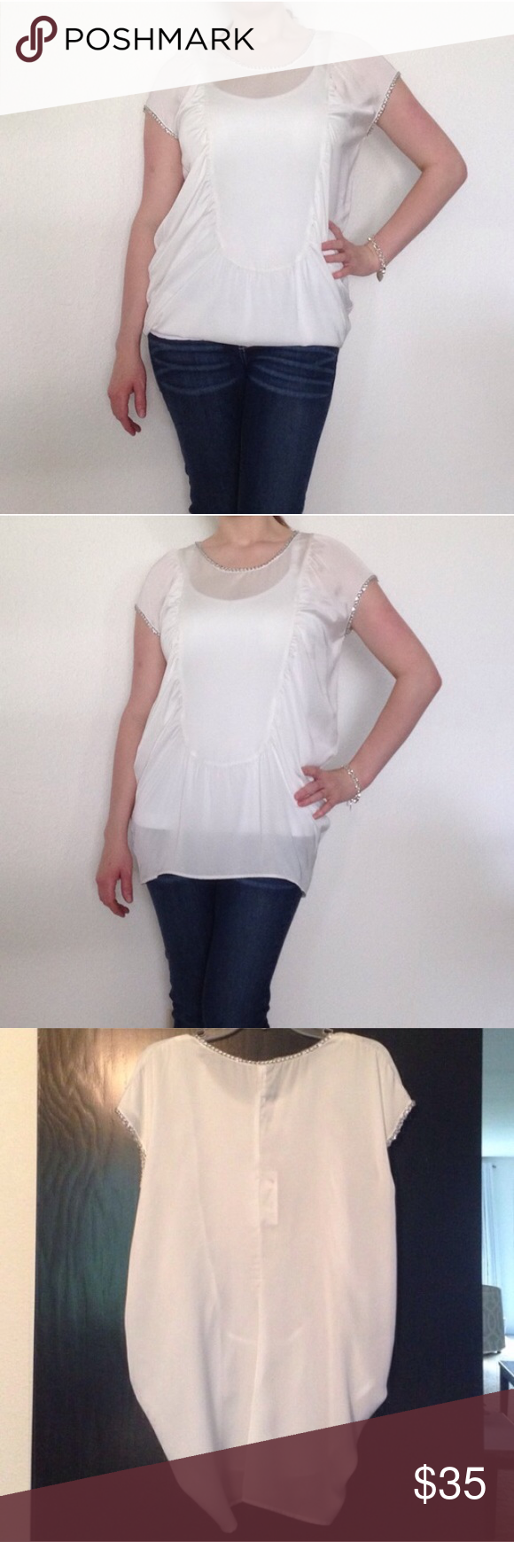"Umgee Silky Top with Chain Lining Beautiful white silky tunic. Neckline and sleeves lined with chains.                                      Size small.   55% cotton 45% polyester. No stretch.    Bust- 22"".  Length- 29"" Umgee Tops Tunics"