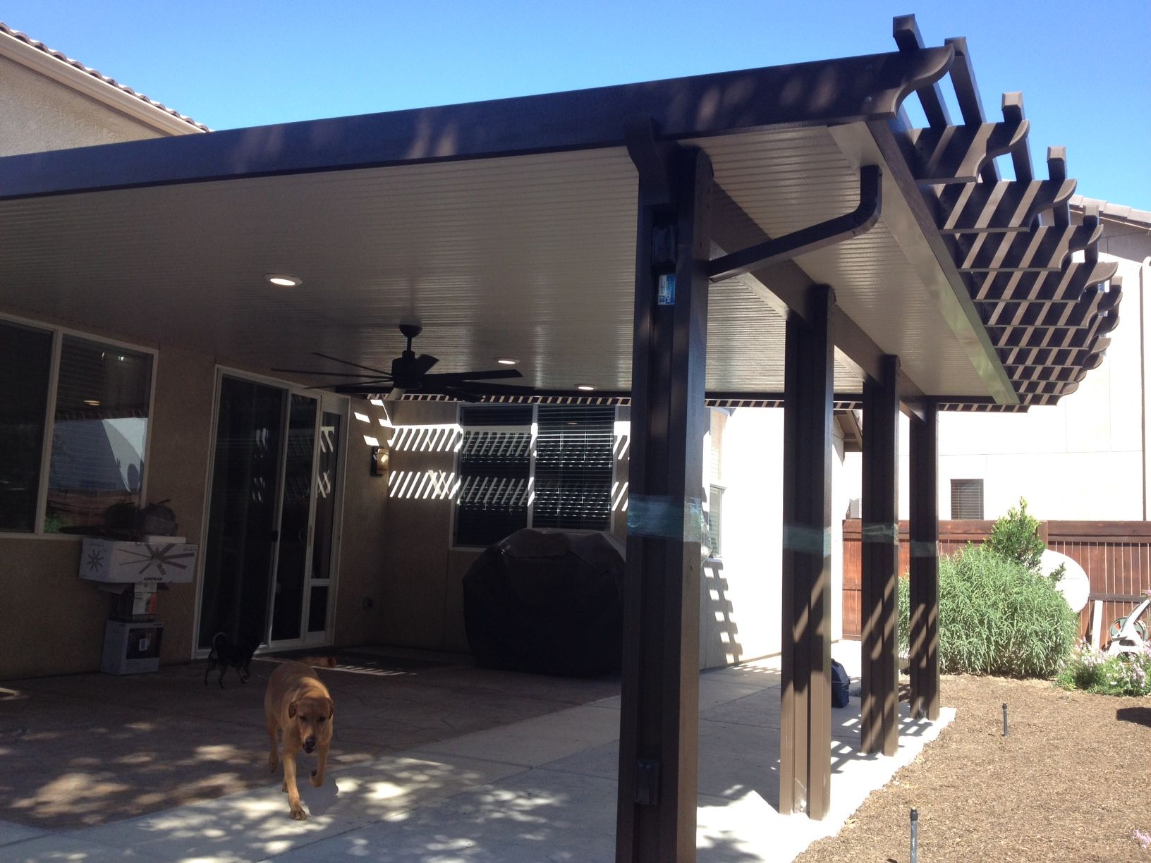 Rafter Tails Style wood grained aluminum patio cover Available in