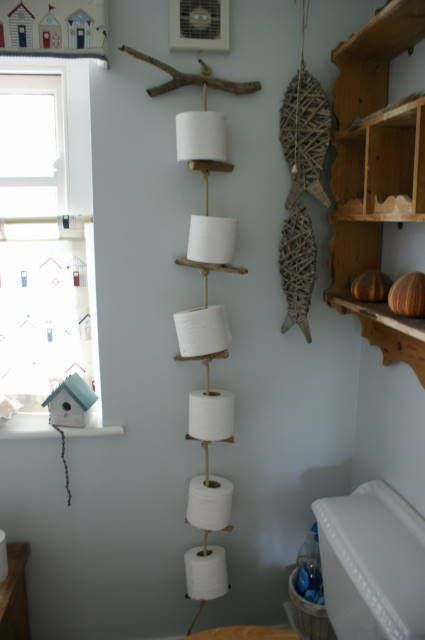 toilet roll holder made from drift wood and old rope simply twist the wood round to remove old. Black Bedroom Furniture Sets. Home Design Ideas