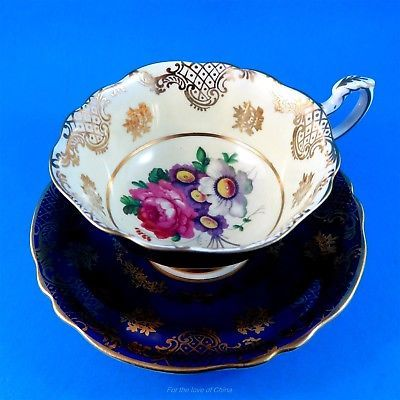 Striking Cobalt and Cream with Floral Center Paragon Tea Cup and Saucer Set