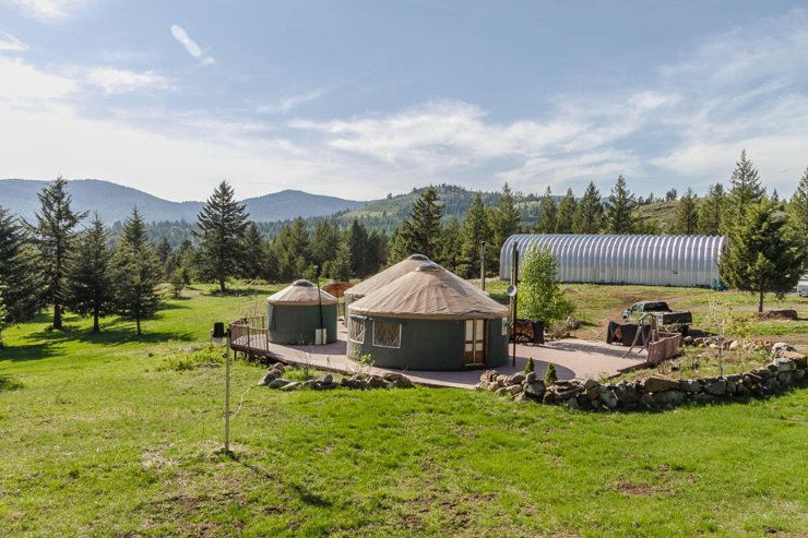 This is a Rustic yurt home, which is the Central Asian-inspired portable dwelling to the next level,  This Yurt sits on a 62 acre property and features not only a main yurt, but also a guest yurt and a bath house.