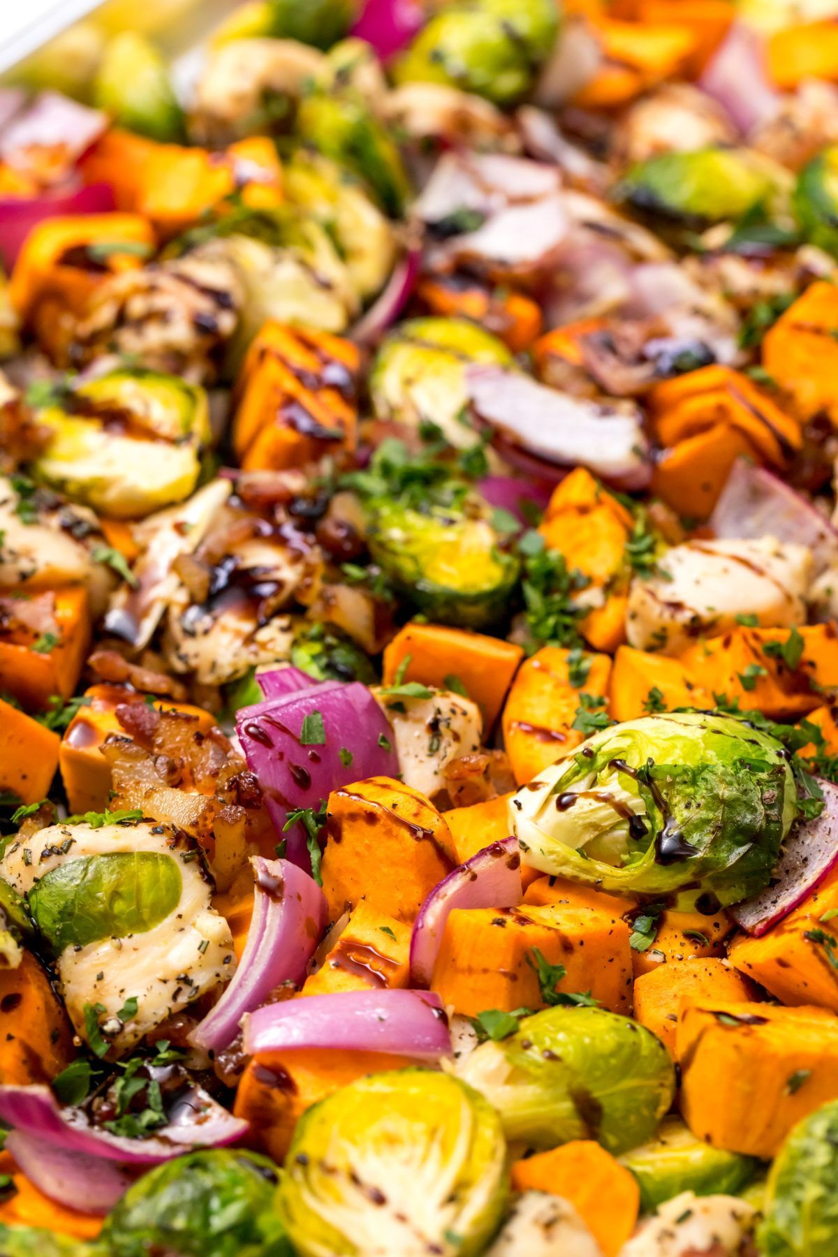 Sheet-pan chicken, sweet potatoes and Brussels sprouts with bacon and balsamic glaze -
