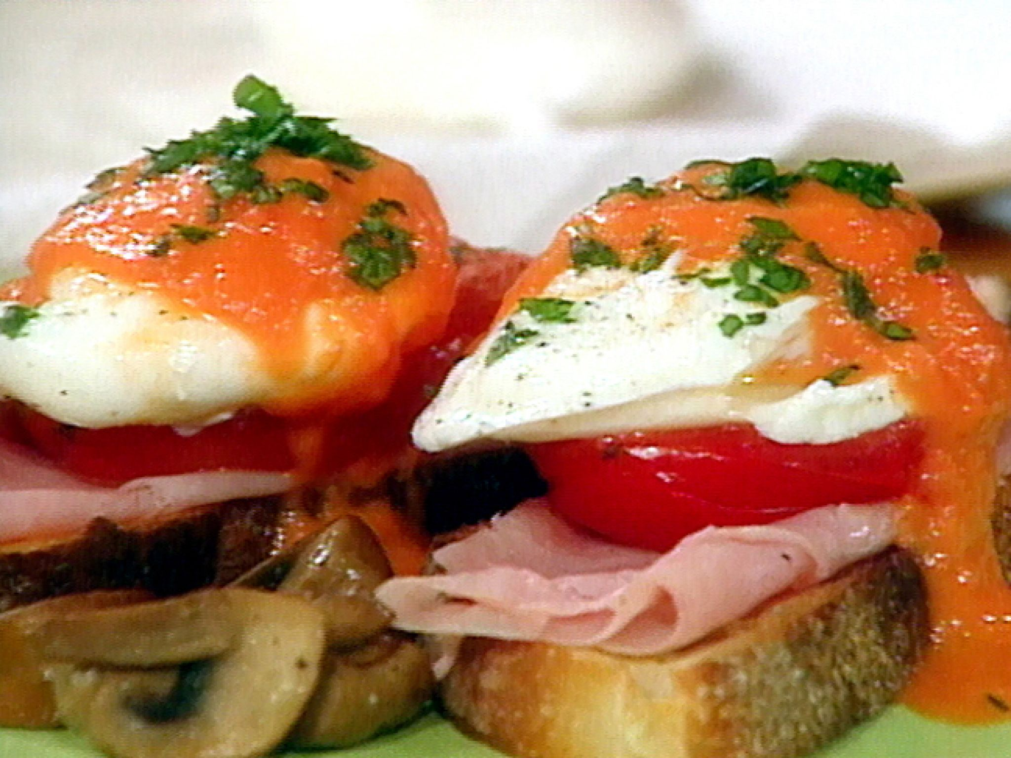 Adam and Eve on a Raft  (Poached Eggs with Roasted Tomatoes, Mushrooms and Ham) recipe from Sara's Secrets via Food Network