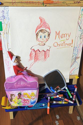 "Elf on the Shelf 2010 (Fizzy) 12/21: ""WOW! Great job Fizzy!"" when she spotted him this morning. She wanted to take crayons/coloring books to her babysitter's today. I think she was inspired by Fizzy's self portrait. It was Grant's turn to assist Fizzy, very nice!"