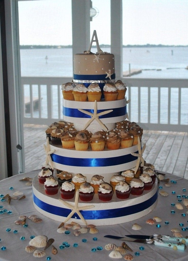 cupcakes to chandeliers   Beach theme wedding cupcake tower with ...