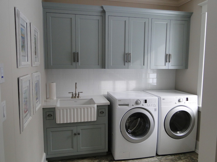 Lovely Laundry Room Features Gray Green Cabinets Painted Benjamin Moore Piedmont Gray Suspended Over A Subway Tile Backsplash And Gray Green Sink Cabinet Topped Laundry Room Inspiration Laundry Room Remodel Laundry