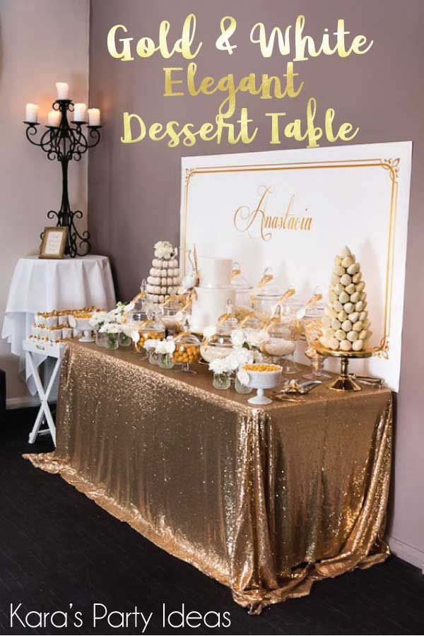 Baptism Dessert Table with a shimmery gold table cloth and towers of sweets | Kara's Party Ideas